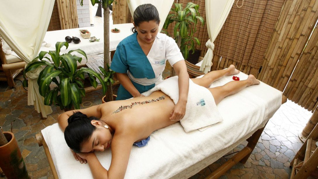 A trained massage therapist giving a guest a specialized spa treatment